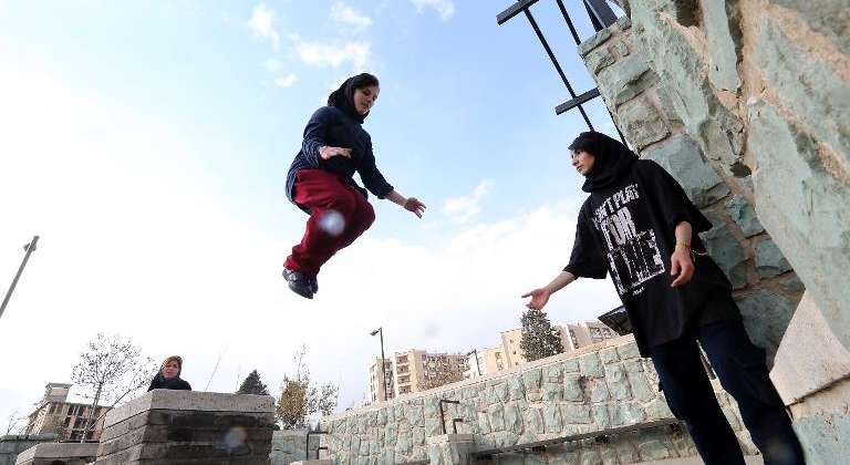 An Iranian woman practices parkour in Tehran